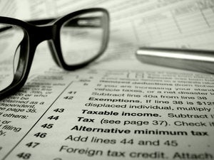 taxes forms glasses calculations fine print
