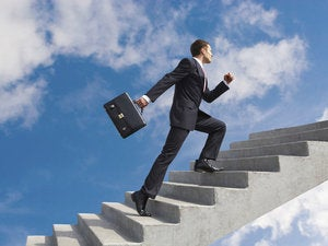 Businessman climbing stairs_120488598