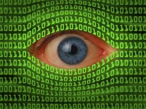 Eye peeking through binary code 175330322