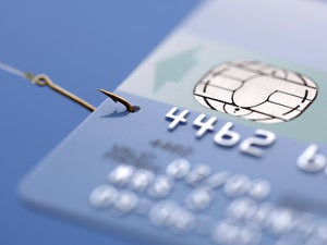 credit card caught on a fishing hook concept for addiction to spending with credit or phishing 9178