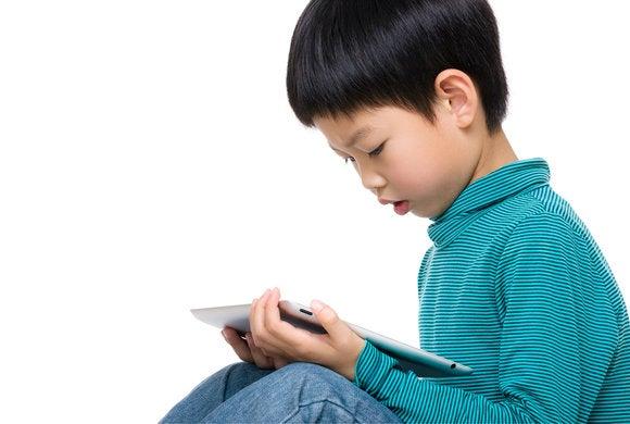 kid reading ipad
