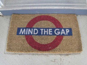 Door mat that says Mind the Gap