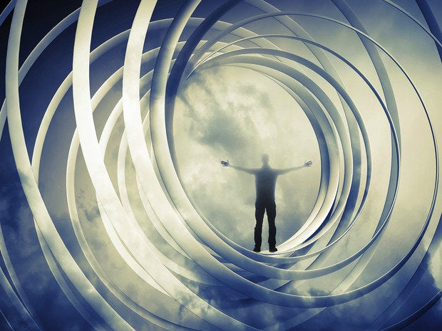 A man stands alone inside spiralling cloud abstraction, on dark twisted tunnel background.