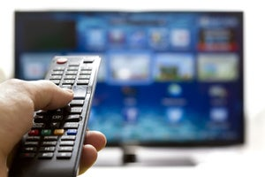 tv with hand on remote stock