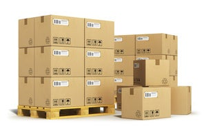 Stacks of moving boxes and parcels on pallets