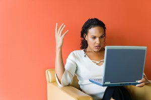 frustrated woman laptop stock