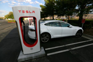 Here's how much Tesla will require EV owners to pay to charge up